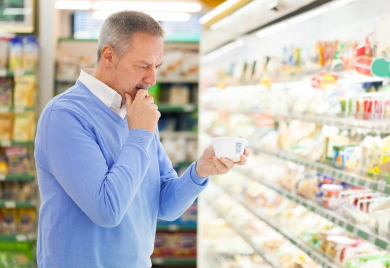 Man checking a supermarket item